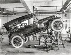 """Circa 1919. """"Studebaker motor car in repair shop with garage mechanic."""" 6.5 x 8.5 inch glass negative from the Wyland Stanley collection of San Francisco historical memorabilia. Shorpy Historic Picture Archive"""