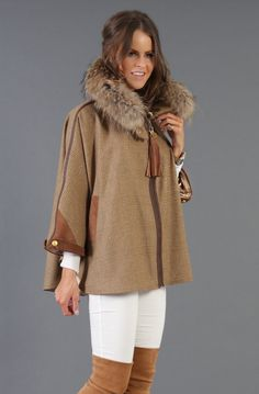 This sumptuous Holland Cooper tweed cape trimmed with authentic suede and embellished with signature gold buttons, oozes style and glamour. Lavishly trimmed with opulent raccoon fur, synchronising both urban and country chic to create a perfect fusion between the two. Unquestionably this garment boasts the ideal trans-seasonal cover up turning tweed firmly on its head.<br /> <br /> <br /> Undoubtedly, the ladies tweed cape will assist you in achieving a flawless, polished celebrity style…