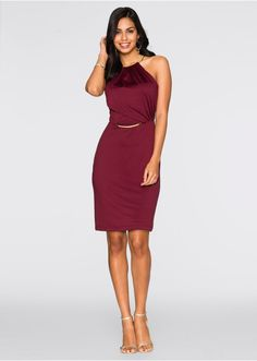 Nápadné šaty značky BODYFLIRT s kovovými detailmi na kruk a na pose, naznačený volán na hornom dieli, dĺžka vo veľ. 36/38 cca 90 cm. Vrchný materiál: 93% polyester, 7% elastan; Podšívka: 100% polyester