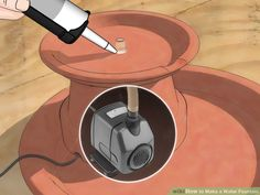 Image intitulée Make a Water Fountain Step 4 How to Make a Water Fountain. Water fountains are the perfect way to add a little Zen to your home, bringing beauty, calm, and nature to your doorstep. In this wikiHow you'll find three fountain designs, all o Small Water Fountain, Tabletop Water Fountain, Cat Fountain, Fountain Design, Rock Fountain, Fountain Ideas, Diy Garden Fountains, Indoor Water Fountains, Indoor Fountain