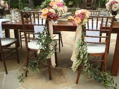 Olive branches on the bride and groom's chairs, at an intimate Montecito wedding. Shot by Beaux Arts Photography.