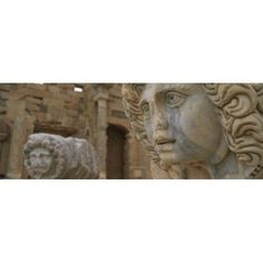 Close-up of statues in an old ruined building Leptis Magna Libya Canvas Art - Panoramic Images (18 x 7)