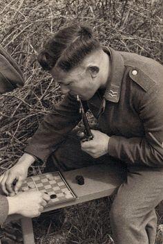 A Luftwaffe Gefreiter plays checkers, via Jedem das seine