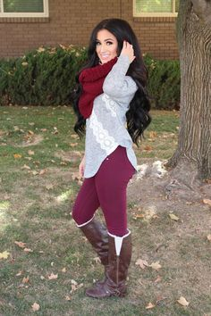 fall outfit: plum color pants, burgundy scarf and brown boots and she has gorgeous hair!!