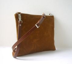 Our simple cross body purse in Saddle Brown Waxed Canvas is lightweight yet durable. With a slim profile and an adjustable leather strap its minimalist, casual style is perfect for everyday use and is just the right size to hold what you need!Leather crossbody strap is adjustable to 6 different sizes and is also completely detachable.Zipper closure keeps the contents secure and 2 interior slip pockets help keep you organized.  Waxed canvas will crease and soften with use giving it a…