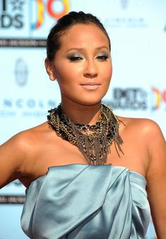 Delightful Adrienne Bailon ...  Yummy Celebrity...   Bailon has announced that she worked with R singer Ne-Yo on a new single, set to be released in Summer of 2012