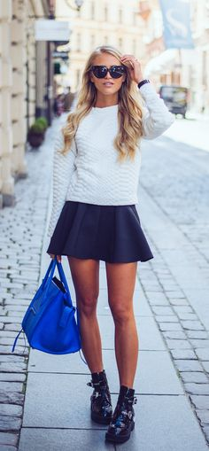 Sweater And Skirt: Janni Deler is wearing sunglasses from River Island, knitted sweater from Jaquard, blue skirt from Choies, bag from Celine and the shoes are from Jeffrey Campbell