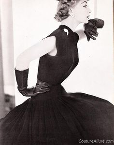 Larry Aldrich jumps into the New Look in 1951 with this dress made of black rayon faille.  The full skirt is pleated onto a dropped waist and measures 4 yards around at the hem.  Sold for $50 in 1951 (about $435 in today's dollar.)