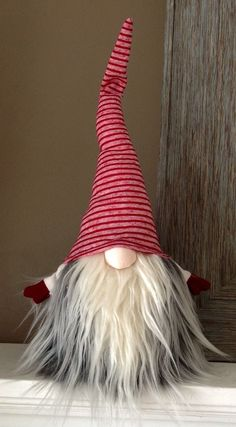 Swedish Norwegian Tomte Nisse Gnome features weighted bottom for extra stability, bendable hat and arms to position any way you desire! There may be slight differences from the ones pictured since each one is individually handmade with lots of love!