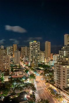 Honolulu night view, #honolulu I was there in the year 2000.  Everyone is out walking at night;)