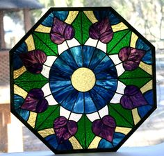 CustomMade by Pam Hansen: Stained glass Victorian Octagon Window also pictured on my web site at AGlassMenagerie.  Prices are determined by size, number of pieces and type of glass used.