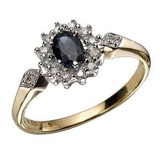 A modern take on a vintage look, this stunning 9ct yellow gold ring features a deep blue sapphire at its centre with a glittering diamond surround for sophisticated sparkle. The look is finished with added delicate diamond detail set in the shoulders. Perfect for timeless elegance.