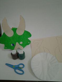 Dinosaur paper plate mask.