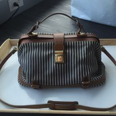 Classic vintage-style Navy striped bag from anthro Leather bag with buckle/hinge mechanism, gently used - great condition Anthropologie Bags Shoulder Bags