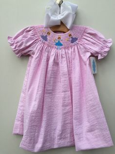 Smocked Fairy Princesses on Pink Seersucker Bishop MBL 15 by lii Traditions Price $33.99, Free Shipping Options:  18M  To purchase comment Sold, Size, and Email Address!  Then connect here: https://www.soldsie.com/pin/660943 www.lambsinivy.com