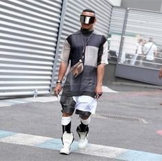 Street style photo of Walfrido Lima in Rick Owens sunglasses, tunic, shorts, socks, white/milk geobaskets worn without laces