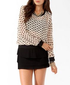 This top would look amazingly cute with a sleek back ponytail & some black skinny jeans with the top tucked in & anytime of cream or black shoes etc! I LOVE FASHION!