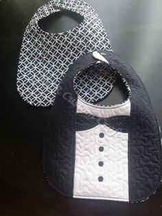 Formal Tux baby bib. Your little guy will be the best dressed at that formal event. This is a reversible bib - one side a formal tux and the other side a black and white print. Approximate size 7 inches x 11 inches.
