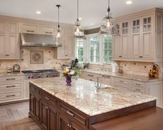 Furniture, Traditional Kitchen With Admirable Off White Kitchen Cabinets Also Brown Kitchen Island With Beige Marble Countertop And Classic Faucet Design Also 3 Antique Pendant Lights Also Cool Laminate Floor Design: Off White Kitchen Cabinets that Suit Your Kitchen