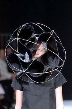 Wearable Art - sculptural 3D headpiece with large spherical wire structure & contoured twists of fabric // Junya Watanabe