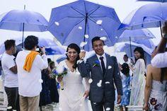 Acuatico beach wedding valentines day petals umrella rain