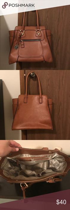 London Fog Weekend Tote Cognac color, super cute! Perfect for an everyday carry all purse! Can fit a MacBook laptop inside length wise. So many pockets for storage! Side pockets, front zip pocket, and inside pockets. Small scuff from handle that is pictured. London Fog Bags Totes