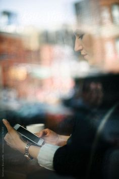 Businesswoman using technology sitting at cafe by Simone Becchetti Business  Women 4cb6f5c7a5a7