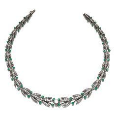 PROPERTY OF A LADY Emerald and Diamond Necklace, Second Half of the Century Composed of a graduating line of leaf motifs, set with circular-cut and rose diamonds, highlighted with circular-cut. Emerald Necklace, Necklace Box, Beaded Necklace, Necklaces, Antique Jewelry, Vintage Jewelry, Antique Necklace, Titanic Jewelry, Green Diamond