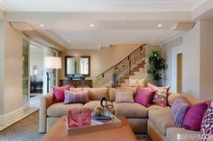 Comfortable family room with pink accents