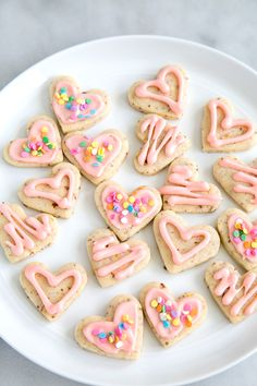 These heart shaped sugar cookies are the perfect treat to make for valentine's day! This recipe is easy to make and results in soft and chewy cookies topped with a homemade icing. They have a tangy hint of citrus to surprise your sweetheart for a non-chocolate dessert!