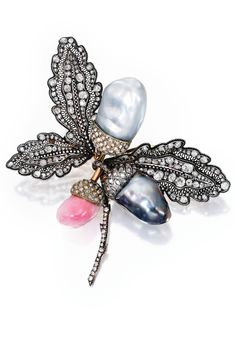 SILVER-TOPPED-GOLD, CONCH PEARL, CULTURED PEARL AND DIAMOND BROOCH, with French import marks.