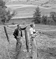 Farmer and boy in the fall of the year at the time the hunting season opens. They live in a white painted house across the road. Jackson County, Oregon, October 1939 Dorothea Lange photo