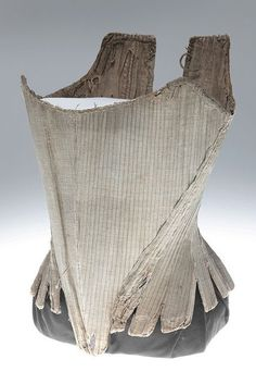Blue Stays - 1775 - Missouri Museum. These stays appear strapless but they do have an eyelet at the top corners, possibly for straps now removed. Possibly 10 panels with CF point being made up of only one panel. Broad CF panel, coming way beyond a natural side seam. Square ended tabs which start below waistline.