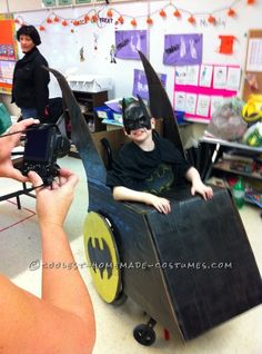 This is a Wheelchair Batmobile Costume I put together for my 10 year old Autistic son. He loves Batman and the villains. He's in the wheel chair as a resul Halloween Costume Contest, Halloween Items, Halloween Costumes For Kids, Girl Superhero Party, Batman Party, Cute Costumes, Costume Ideas, Wheelchair Costumes, Disney Dress Up