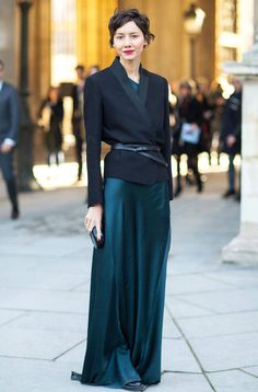 Trending Fashion Style: Men's Tuxedo Jacket over the Dress. Black tuxedo jacket styled with a belt wrapped around the waist over jewel-tone green dress street style during Fall Winter 2014 Paris Fashion Week.