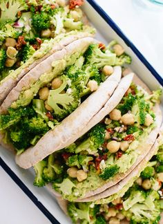 This simple pita sandwich recipe features a fresh broccoli and chickpea slaw with Greek flavors, on a pita with mashed avocado!