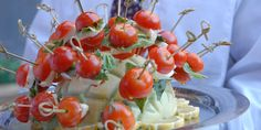 Great idea for your next event: mini caprese skewers -- Ralph Brennan Catering & Events!
