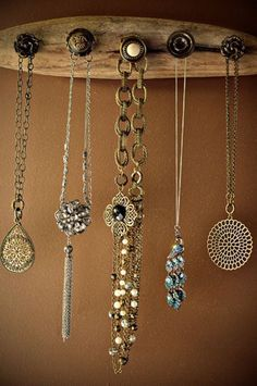 DIY Crafts : An old plank of wood and small knobs to hold your jewelery. Love it!