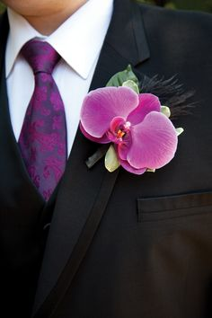 Orchid and feather boutonniere.    Photography courtesy of Corina V. Photography.