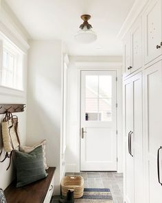 Modern Farmhouse Mudroom Entryway Ideas Home Decor One of the best ways to spruce up an entryway is to use entryway ideas from other places. If you have a house that has a modern look to it, you may wa. House Design, Mudroom, House, Home, Foyer Lighting Entryway, Foyer Decorating, Mudroom Design, New Homes, Farmhouse Mudroom