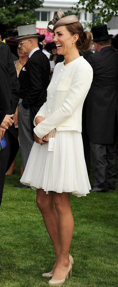 Catherine attends the Epsom Downs Racecourse on June 4, 2011 in a white chiffon dress from Reiss and a white tweed jacket, where she watched the queen's horse take third place.