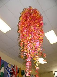 Must try this one too! Paint swirled inside water bottles, then cut to make Chihuly sculpture
