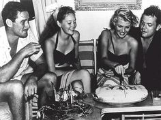 Errol Flynn and his wife Nora Eddington con Rita Hayworth and Orson Welles