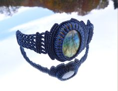 This beautiful Labradorite Gemstone caught in my blue net shines in all of his colors. I used a double half hitch knot and a polyester waxed cord.