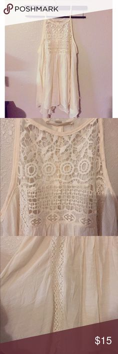 🔲Trapeze Boho Top🔲 This top is so perfect. It has Lace in the front and a little bit of Lace trim on the sides. It's a cream color. Rebellion Tops Tunics