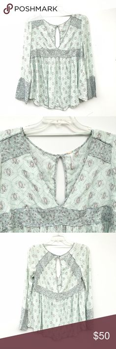 NWOT Free People Mint Printed Double V-Neck Top Beautiful mint green and printed top by Free People. Looks like the very roots of the brand itself; breezy, loose, and deep v-necks on the back and front. Brand new without tags and unworn. Free People Tops Tunics