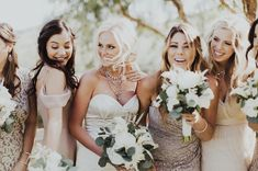 Bridesmaids in mismatched blush + metallic dresses