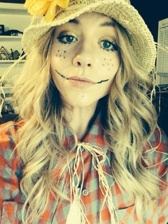 flannel & jeans, straw from craft store, dollar store hat, fall flowers/colors -then go crazy! then do your thing with the orig scarecrow makeup :)