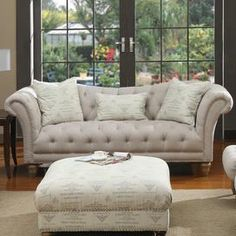 """Diamond-tufted loveseat with rolled arms and a wood frame.            Product: Loveseat    Construction Material: Hardwood frame, art silk and hemp-polyester     Color: Beige     Features:     Button-tufting   No sag springTwo square accent pillows and one kidney pillow included        Dimensions: 34"""" H x 67"""" W x 36"""" DNote: Ottoman not included"""