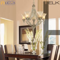 This stunning ELK Lighting chandelier blends the traditional with the modern beautifully. Love it!